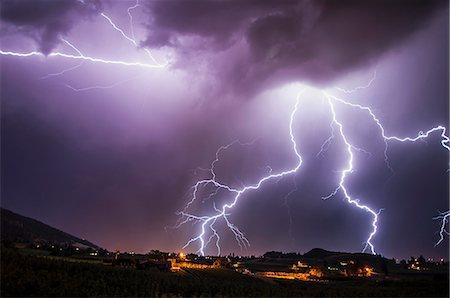 Lightning bolts over south Okanagan Valley, Penticton, British Columbia, Canada Stock Photo - Premium Royalty-Free, Code: 614-07487149