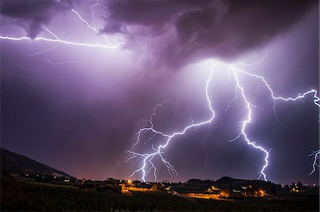 Lightning bolts over south Okanagan Valley, Penticton, British Columbia, Canada Stock Photo - Premium Royalty-Free, Code: 614-07487149