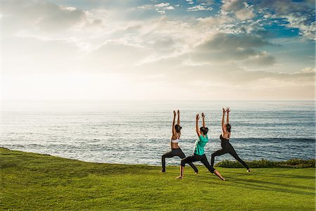 stretching (people exercising) - Women on cliff, in yoga position Stock Photo - Premium Royalty-Free, Code: 614-07487190