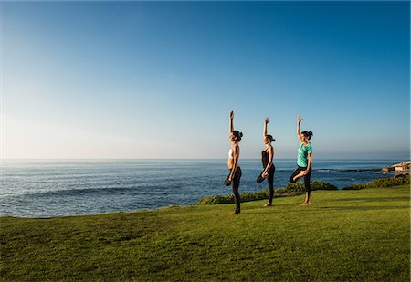stretching (people exercising) - Women on cliff, in yoga positions Stock Photo - Premium Royalty-Free, Code: 614-07487191
