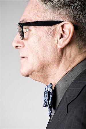 portrait - Portrait of senior man wearing bowtie, side view Stock Photo - Premium Royalty-Free, Code: 614-07487227