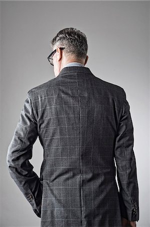 Portrait of senior man, wearing suit, rear view Stock Photo - Premium Royalty-Free, Code: 614-07487222