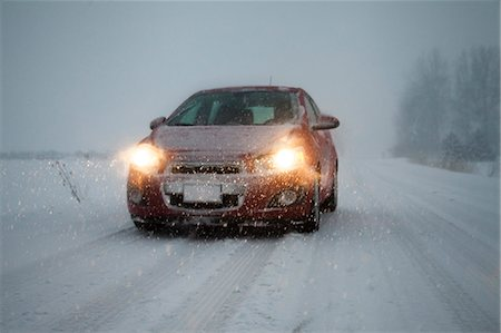 remote car - Car with headlights on driving along foggy snow covered road Stock Photo - Premium Royalty-Free, Code: 614-07487241