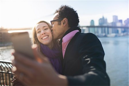 partnership - Young couple taking selfie and kissing, New York, USA Stock Photo - Premium Royalty-Free, Code: 614-07587554