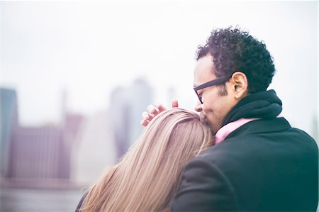Affectionate young couple and Manhattan skyline, New York, USA Stock Photo - Premium Royalty-Free, Code: 614-07587551