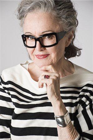 portrait - Portrait of senior woman, hand on chin Stock Photo - Premium Royalty-Free, Code: 614-07587683