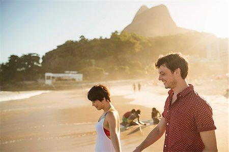 south american woman - Young couple enjoying sunset, Ipanema Beach, Rio, Brazil Stock Photo - Premium Royalty-Free, Code: 614-07652203