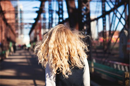 Young woman walking over bridge Stock Photo - Premium Royalty-Free, Code: 614-07652219