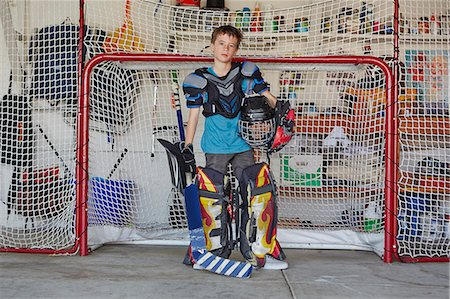sports and hockey - Boy in hockey goal wearing protective sportswear Stock Photo - Premium Royalty-Free, Code: 614-07652250