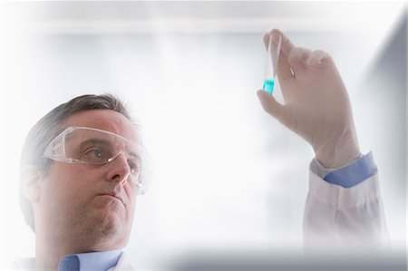 Scientist looking at test tube Stock Photo - Premium Royalty-Free, Code: 614-07652261
