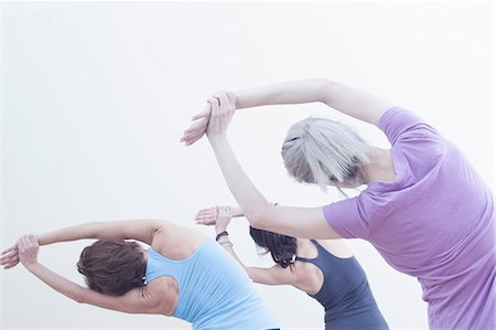 senior women - Women practising yoga Stock Photo - Premium Royalty-Free, Code: 614-07652299