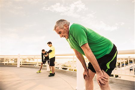 Exhausted male runners taking a break from training Stock Photo - Premium Royalty-Free, Code: 614-07652364