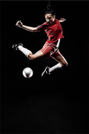 footballeur - Young woman jumping for football Stock Photo - Premium Royalty-Free, Code: 614-07652389