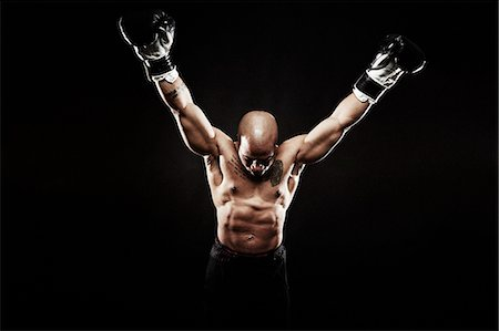 shirtless men - Boxer with arms raised Stock Photo - Premium Royalty-Free, Code: 614-07652401