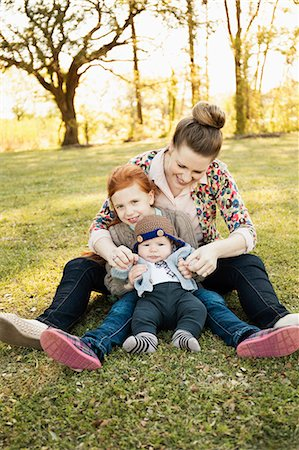 Portrait of mid adult mother, daughter and baby son in park Stock Photo - Premium Royalty-Free, Code: 614-07652495