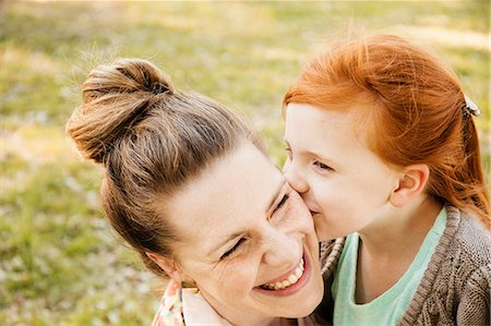 Portrait of smiling mid adult mother and daughter in park Stock Photo - Premium Royalty-Free, Code: 614-07652497