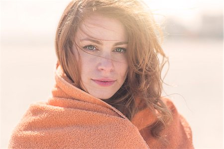 summer - Close up portrait of young woman wrapped in blanket Stock Photo - Premium Royalty-Free, Code: 614-07708178