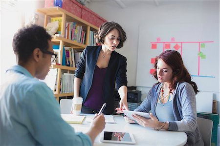 small - Young woman leading small meeting Stock Photo - Premium Royalty-Free, Code: 614-07708204
