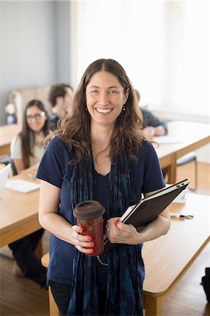 Teacher with notebook and coffee, portrait Stock Photo - Premium Royalty-Free, Code: 614-07708304