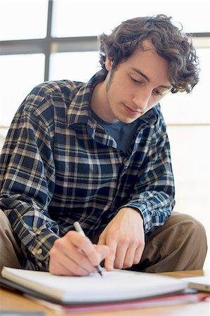 Student making notes Stock Photo - Premium Royalty-Free, Code: 614-07708313