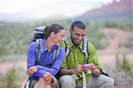 fitness   mature woman - Hiking couple reading message on smartphone, Sedona, Arizona, USA Stock Photo - Premium Royalty-Free, Code: 614-07708333