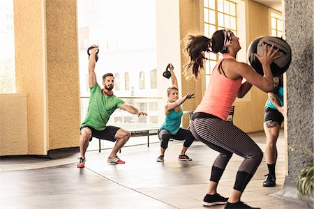 Group of adults doing crossfit workout Stock Photo - Premium Royalty-Free, Code: 614-07735291