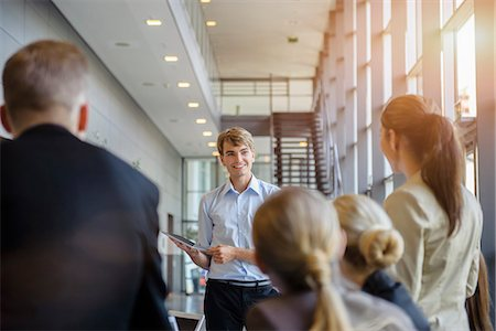 Businessmen and businesswomen at brainstorming meeting Stock Photo - Premium Royalty-Free, Code: 614-07735334
