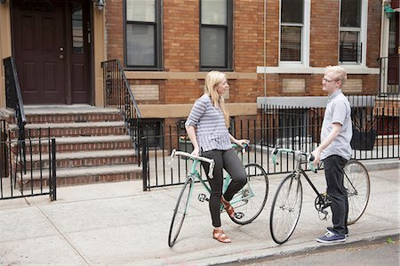 flat (apartment) - Young couple with bicycles chatting on street Stock Photo - Premium Royalty-Free, Code: 614-07735412