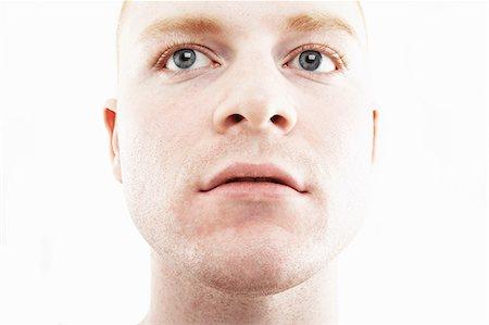 portrait - Close up studio portrait of young man Stock Photo - Premium Royalty-Free, Code: 614-07735579