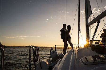 silhouettes - Couple on yacht, silhouette Stock Photo - Premium Royalty-Free, Code: 614-07768051