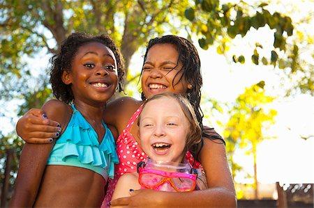 Three girls laughing in garden Stock Photo - Premium Royalty-Free, Code: 614-07768071