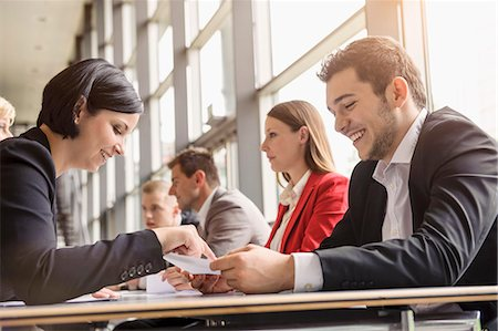 Business colleagues sharing ideas at meeting Stock Photo - Premium Royalty-Free, Code: 614-07768127