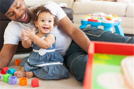 Father playing with young daughter Stock Photo - Premium Royalty-Free, Code: 614-07768264