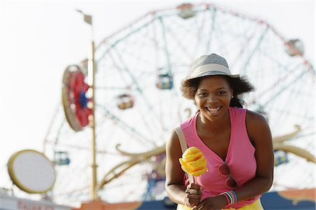 Portrait of young woman with ice cream cone, Coney Island, Brooklyn, New York, USA Stock Photo - Premium Royalty-Free, Code: 614-07768305