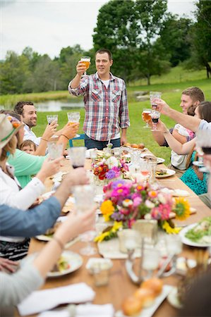 Family and friends making a toast at outdoor meal Stock Photo - Premium Royalty-Free, Code: 614-07806389