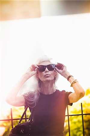 Hip senior woman wearing sunglasses Stock Photo - Premium Royalty-Free, Code: 614-07806432