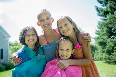 preteen bathing suit - Girls in swimming costume wrapped in towels Stock Photo - Premium Royalty-Free, Code: 614-07806466