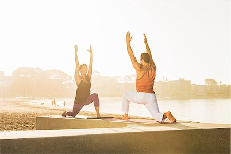 Young man and woman doing yoga on pier at Pacific beach, San Diego, California, USA Stock Photo - Premium Royalty-Free, Code: 614-07806504