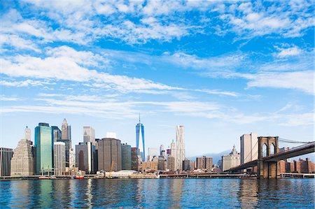 View of Brooklyn Bridge and Lower Manhattan skyline, New York, USA Stock Photo - Premium Royalty-Free, Code: 614-07806517