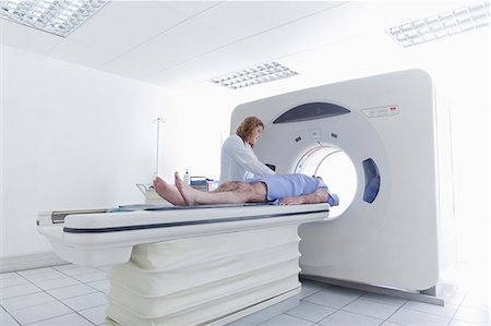 Doctor preparing patient for CT scanning Stock Photo - Premium Royalty-Free, Code: 614-07806555