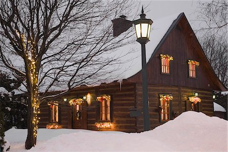 Reconstructed 1840s residential log home with Christmas decorations at dusk, Quebec, Canada Stock Photo - Premium Royalty-Free, Code: 614-07806567