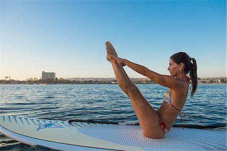fitness   mature woman - Mature woman in yoga position on paddleboard, Mission Bay, San Diego, California, USA Stock Photo - Premium Royalty-Free, Code: 614-07911737