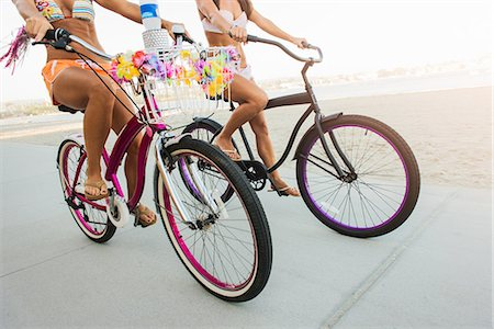 Neck down view of two women cyclists on beach, Mission Bay, San Diego, California, USA Stock Photo - Premium Royalty-Free, Code: 614-07911747