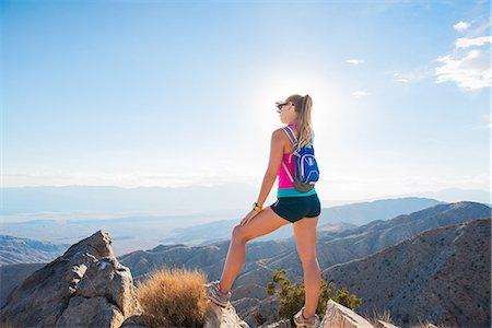 Woman taking break on mountain, Joshua Tree National Park, California, US Stock Photo - Premium Royalty-Free, Code: 614-07911770