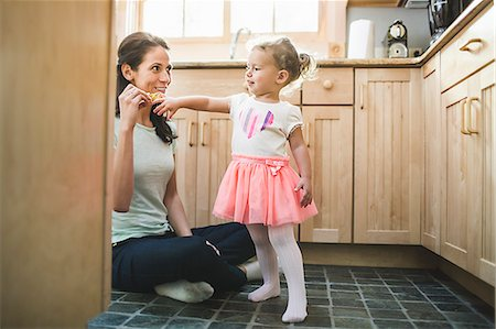 Mother and daughter playing in kitchen Stock Photo - Premium Royalty-Free, Code: 614-07911835