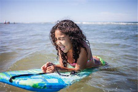 Girl playing on bodyboard, Truro, Massachusetts, Cape Cod, USA Stock Photo - Premium Royalty-Free, Code: 614-07911903
