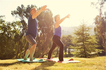 Mature couple practicing yoga position in park Stock Photo - Premium Royalty-Free, Code: 614-07911933