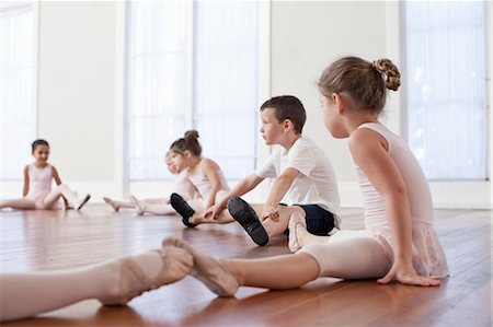 Children sitting on floor practicing ballet position in ballet school Stock Photo - Premium Royalty-Free, Code: 614-07911975