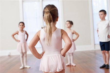 Four children practicing ballet with hands on hips in ballet school Stock Photo - Premium Royalty-Free, Code: 614-07911978