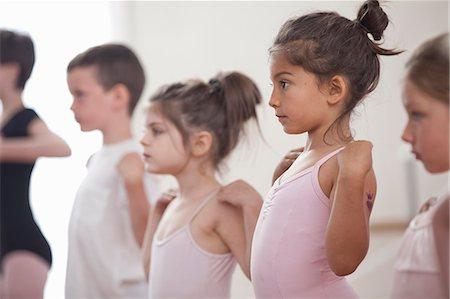 Row of children practicing in ballet school Stock Photo - Premium Royalty-Free, Code: 614-07911980